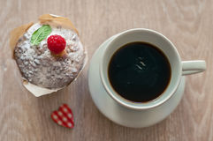 Coffee with muffin. Black aromatic coffee with a fresh muffin and raspberries for Breakfast Stock Photos