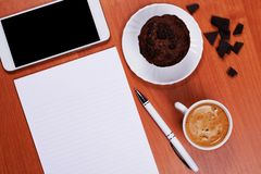 Coffee and muffin at the working place royalty free stock image