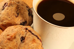 Coffee and Muffins. Close up of Coffee and Blueberry Muffins royalty free stock images