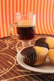 Coffee and muffins Stock Images