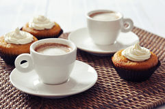 Coffee with muffins. Cup of coffee with muffins on rattan placemat Stock Photos
