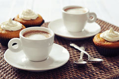 Coffee with muffins Stock Images