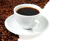 Coffee mug. Against the backdrop of coffee beans royalty free stock images