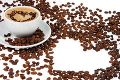 Coffee mug. Against the backdrop of coffee beans stock photography