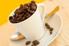 Coffee Mug. Coffee cup with coffee beans inside Royalty Free Stock Photos