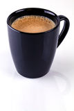 Coffee Mug. Black mug with fresh brewed coffee Royalty Free Stock Images