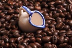 Coffee mug. Coffee beans with little mug Stock Photo