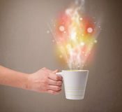 Coffee mug with abstract steam and colorful lights Royalty Free Stock Photos