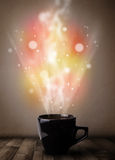 Coffee mug with abstract steam and colorful lights Stock Images