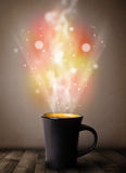 Coffee mug with abstract steam and colorful lights Royalty Free Stock Photo
