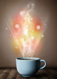 Coffee mug with abstract steam and colorful lights Stock Photo
