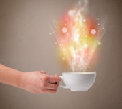 Coffee mug with abstract steam and colorful lights Stock Photos