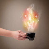 Coffee mug with abstract steam and colorful lights Royalty Free Stock Photography