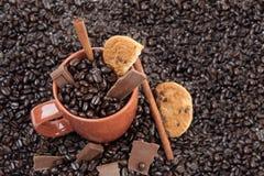 Coffee Mug with Beans Stock Photos