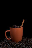 Coffee mug with beans Stock Photo
