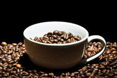 Coffee mug with beans Stock Image