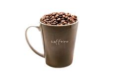 Coffee mug. A mug of coffee beans Stock Images