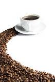 Coffee. Mug of coffee with coffee beans in the foreground Royalty Free Stock Photo