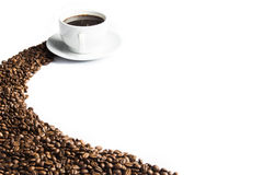Coffee. Mug of coffee with coffee beans in the foreground Stock Image
