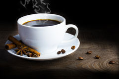 Coffee. Mug of coffee with coffee beans and star aniseed and cinnamon Stock Image