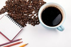 Coffee mug with coffee beans stock photo