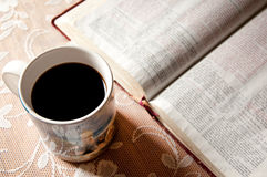 Coffee mug and Bible Stock Images