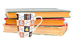 Coffee mug and books on white background Royalty Free Stock Photos