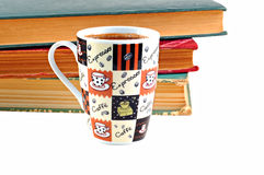 Coffee mug and books on white background Stock Photography