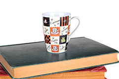 Coffee mug and books on white background. Coffee mug and books on a white background Royalty Free Stock Photography