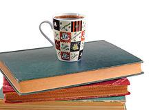 Coffee mug and books on a white background Royalty Free Stock Photos