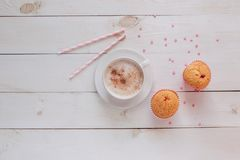 Coffee mug with cake and notes good morning on white rustic table from above, cozy and tasty breakfast Stock Images