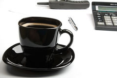 Coffee mug, calculator, pens, phone Royalty Free Stock Photo