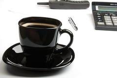 Coffee mug, calculator, pens, phone Royalty Free Stock Photo