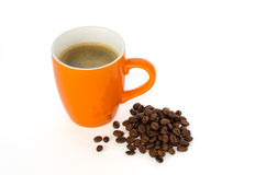 Coffee in a mug and coffee beans Royalty Free Stock Image