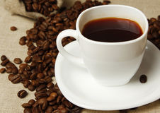 Coffee mug and coffee beans Stock Images