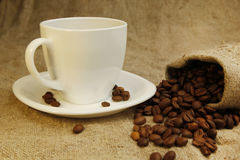 Coffee mug and coffee beans Royalty Free Stock Photos