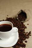 Coffee mug and coffee beans Royalty Free Stock Image