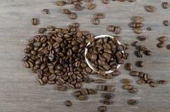 A coffee mug of coffee beans Stock Photography
