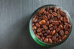 Coffee mug of coffee beans on Dark vintage background.  stock image
