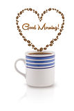 Coffee mug with coffee beans shaped heart with good morning sign Royalty Free Stock Photos