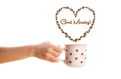 Coffee mug with coffee beans shaped heart with good morning sign Stock Photo
