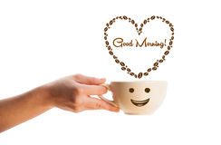 Coffee mug with coffee beans shaped heart with good morning sign Stock Image
