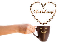 Coffee mug with coffee beans shaped heart with good morning sign Stock Images