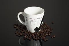 Coffee mug and coffee beans Stock Photo