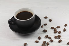 Coffee mug and coffee breans on wood backgound Stock Image