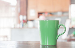 Coffee mug in coffee shop Royalty Free Stock Images