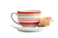 Coffee mug and colored butter biscuits Stock Photo