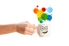 Coffee-mug with colorful abstract speech bubble Royalty Free Stock Photography