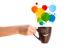 Coffee-mug with colorful abstract speech bubble Stock Photography