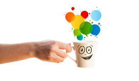 Coffee-mug with colorful abstract speech bubble Royalty Free Stock Images